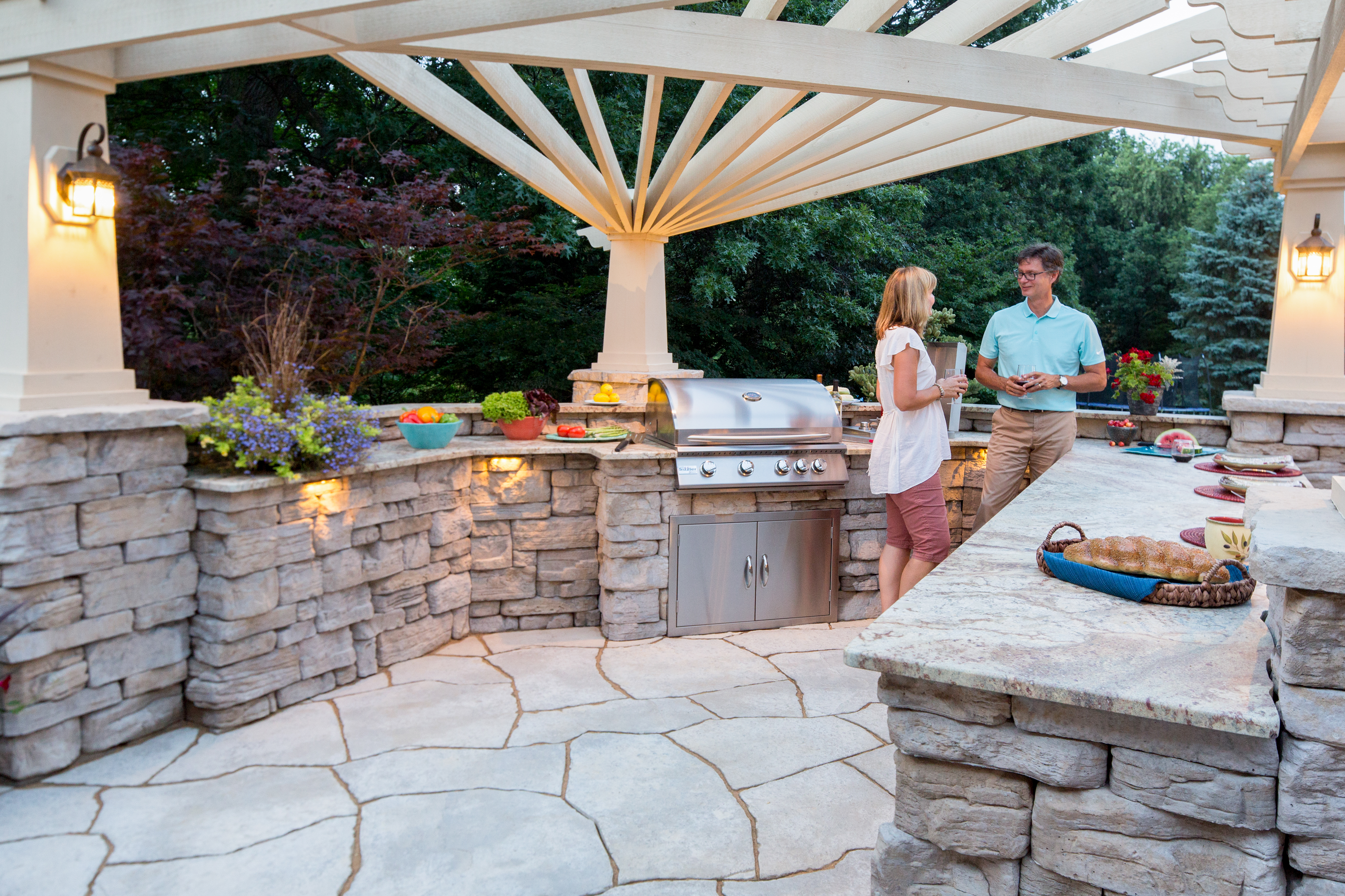 "The natural beauty of Belvedere Walls will turn heads, but the detailed textures will keep them looking. Other products shown: Grand Flagstone and 27"" Column Cap"