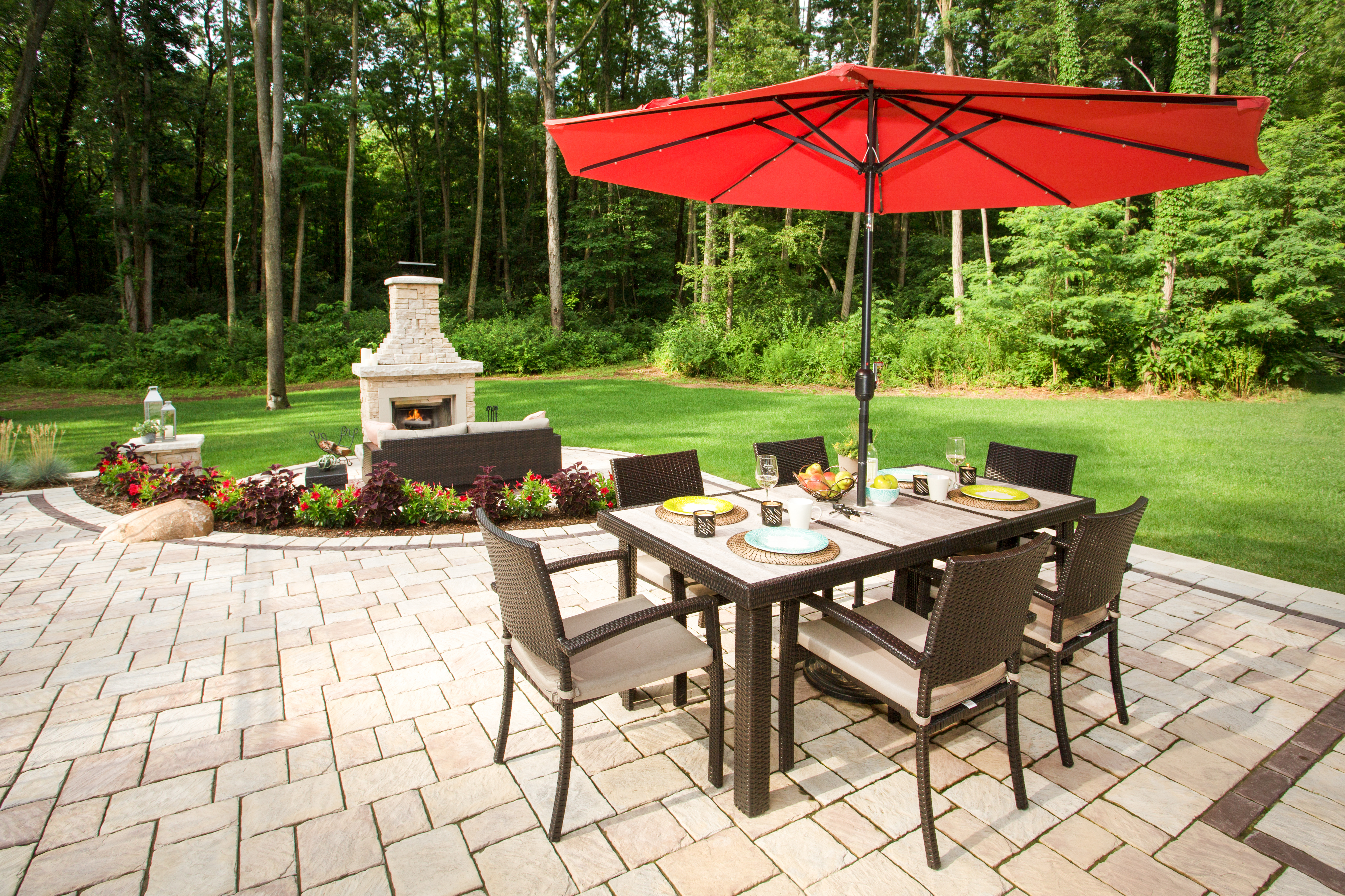 Making time to spend with family and friends doesn't have to be hard when you have a beautiful New Mission patio to share. Products shown: New Mission and Belvedere Fireplace Kit