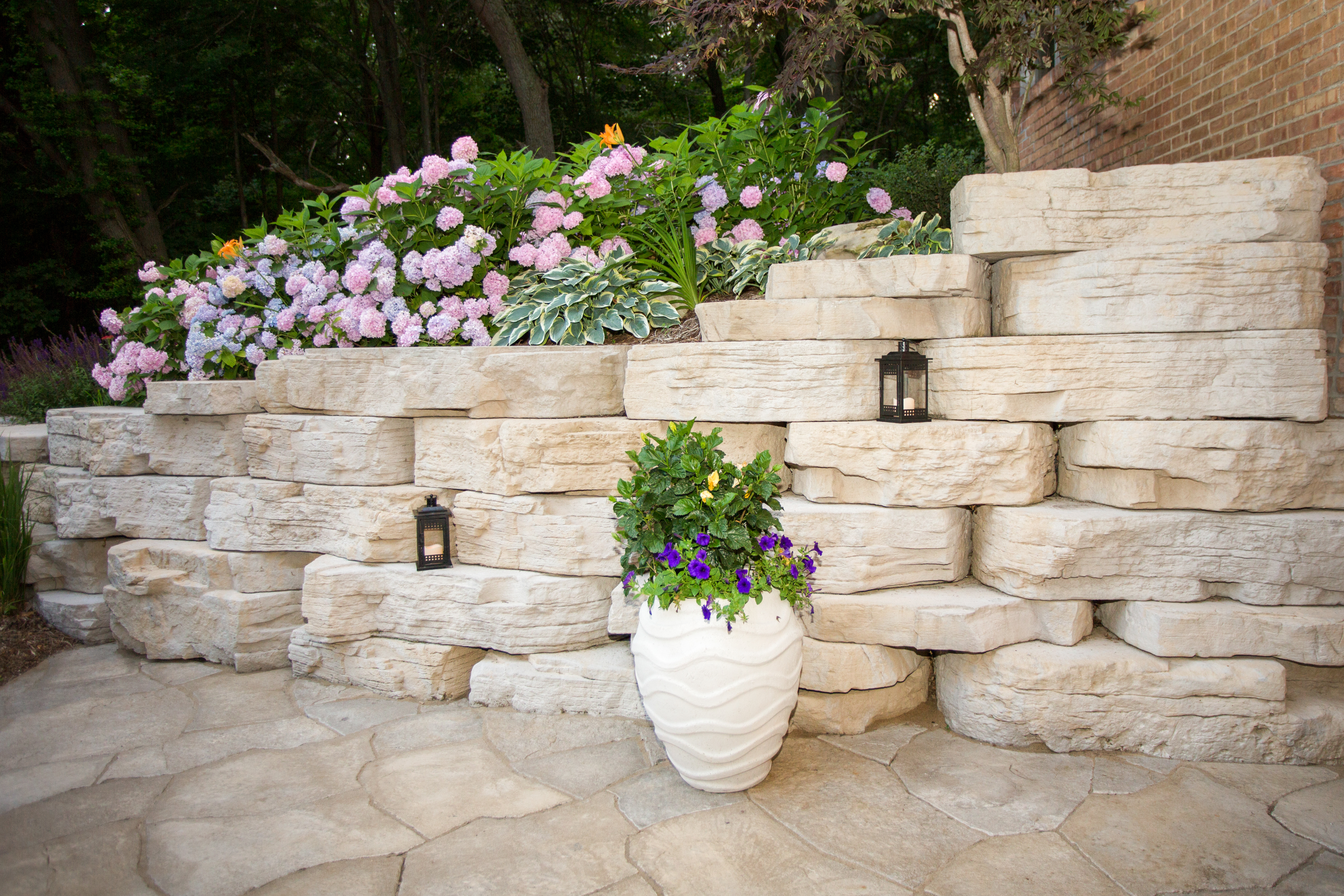 Create a nook to showcase your green thumb with Rosetta's Outcropping Collection. Products shown: Outcropping and Grand Flagstone